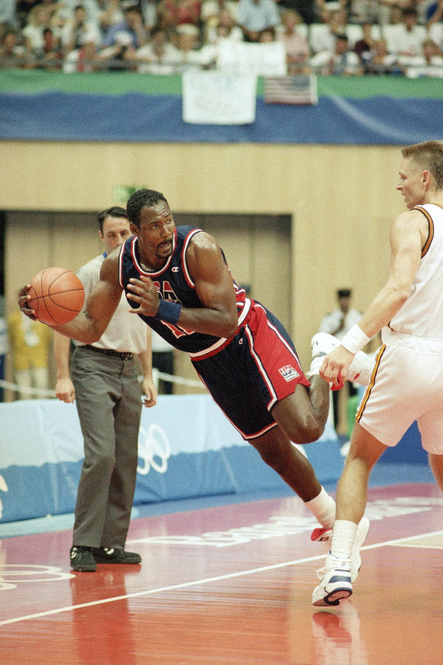 USA's Karl Malone looks to pass as he keeps the ball in play during their preliminary basketball game with Germany at the XXV Summer Olympics in Barcelona, Wednesday night, July 29, 1992. (AP Photo/Susan Ragan)