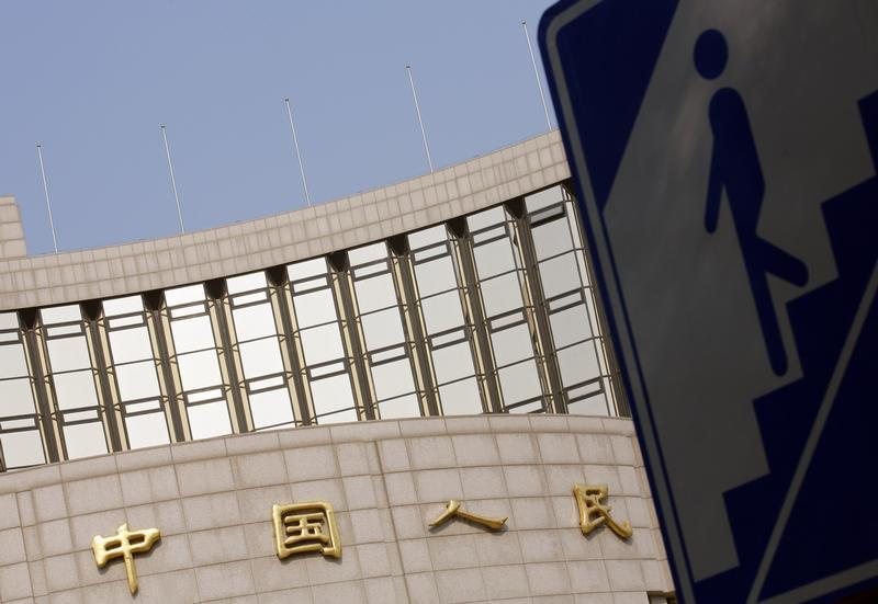 Sign showing the entrance to an underway passage is seen outside the headquarters of the People's Bank of China, the central bank, in Beijing