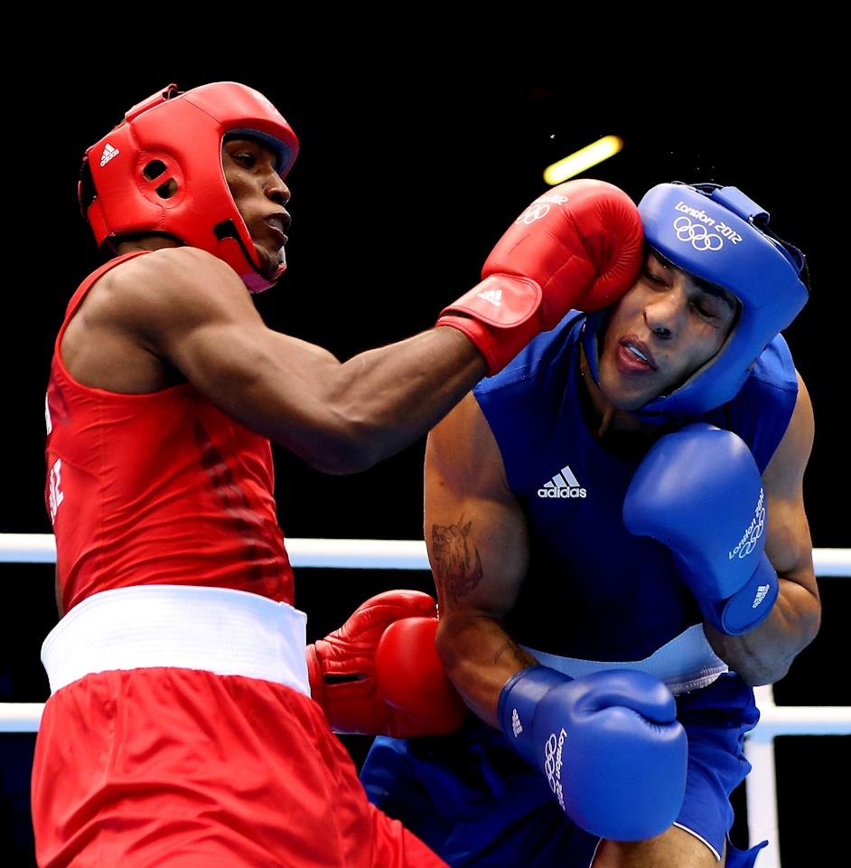 LONDON, ENGLAND - AUGUST 04:  Julio la Cruz Peraza of Cuba (L) in action with Ihab Almatbouli of Jordan during the Men's Light Heavy (64kg) Boxing on Day 8 of the London 2012 Olympic Games at ExCeL on August 4, 2012 in London, England.  (Photo by Scott Heavey/Getty Images)
