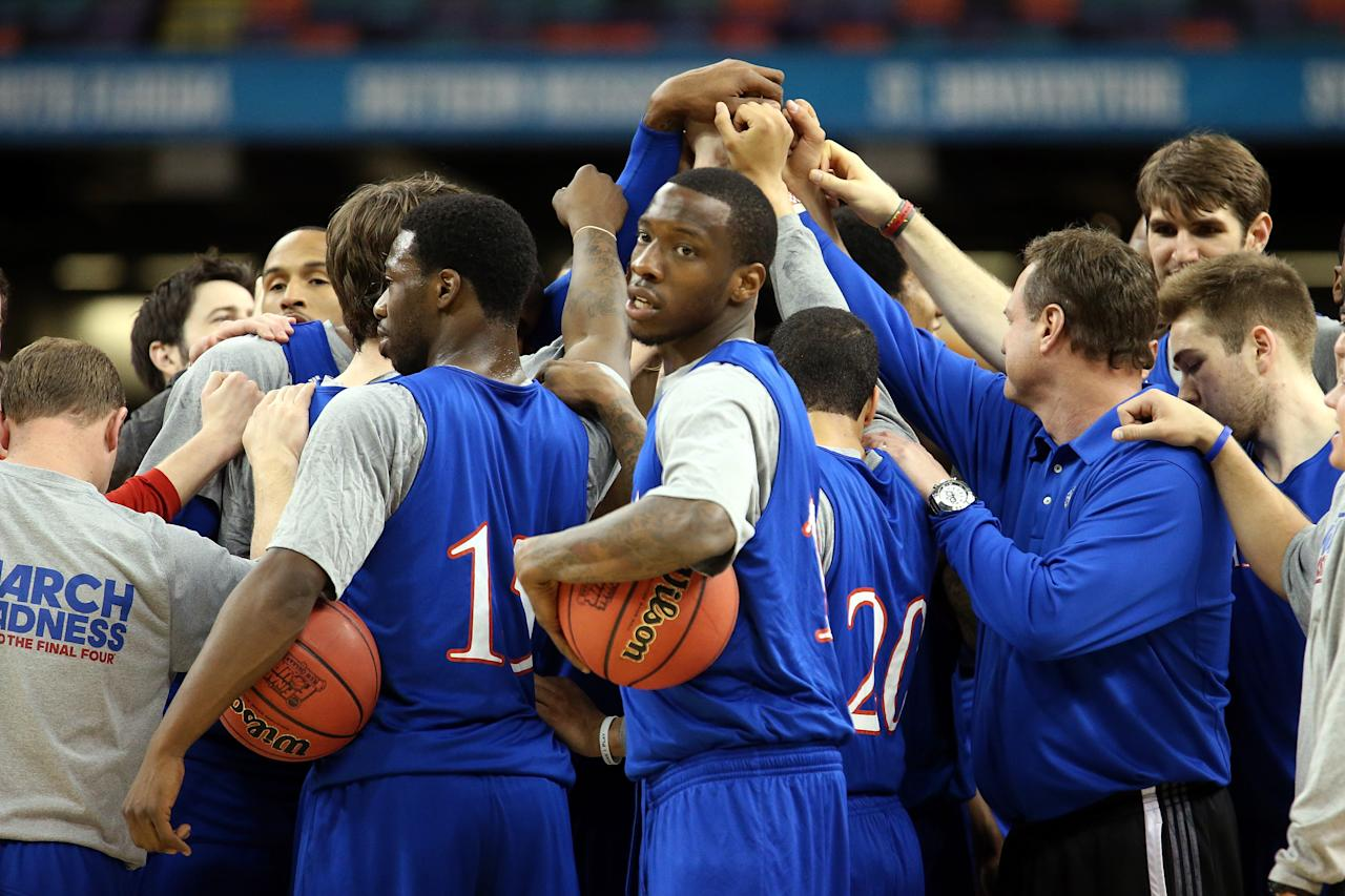 NEW ORLEANS, LA - MARCH 30:  (C) Tyshawn Taylor #10 of the Kansas Jayhawks huddles with his team during practice prior to the 2012 Final Four of the NCAA Division I Men's Basketball Tournament at the Mercedes-Benz Superdome on March 30, 2012 in New Orleans, Louisiana.  (Photo by Ronald Martinez/Getty Images)