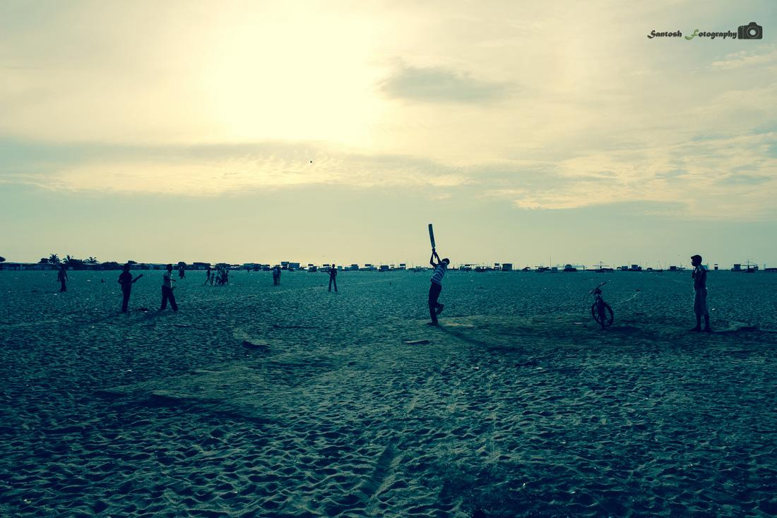 Morning cricket at the Marina Beach in Chennai. It was unbelievable batting. You can see the ball in the air captured in this snap. By Satosh Lyon