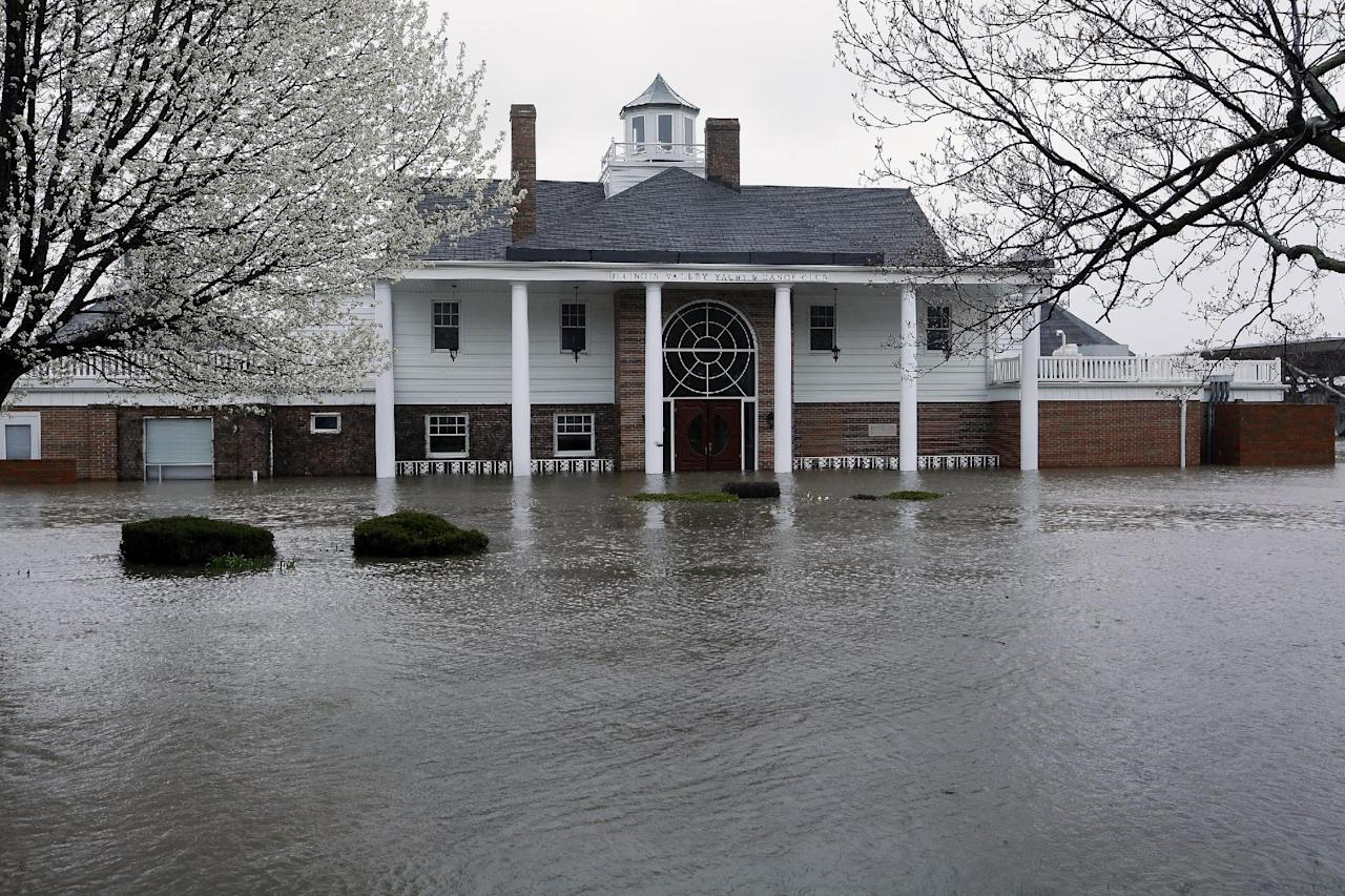 The Illinois Valley Yacht and Canoe Club is surrounded by water as the Illinois River rises out of it's banks flooding businesses and homes Tuesday, April 23, 2013, in Peoria Heights, Ill. Floodwaters are rising to record levels along the Illinois River in central Illinois. (AP Photo/Seth Perlman)