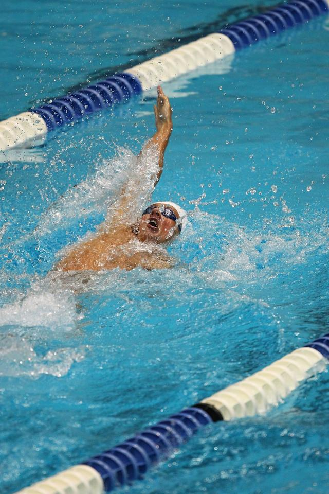 INDIANAPOLIS, IN - MARCH 30: Ryan Lochte swims in the men's 200 meter backstroke finals during day two of the Indy Grand Prix @ the Nat at the Indiana University Natatorium on March 30, 2012 in Indianapolis, Indiana.  (Photo by Dilip Vishwanat/Getty Images)