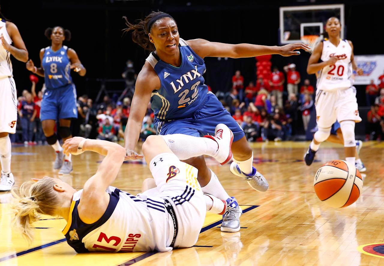 INDIANAPOLIS, IN - OCTOBER 21: Monica Wright #22 of the Minnesota Lynx runs into Erin Phillips #13 of the Indiana Fever for an offensive foul during Game Four of the 2012 WNBA Finals on October 21, 2012 at Bankers Life Fieldhouse in Indianapolis, Indiana. NOTE TO USER: User expressly acknowledges and agrees that, by downloading and or using this Photograph, user is consenting to the terms and conditions of the Getty Images License Agreement. (Photo by Michael Hickey/Getty Images)