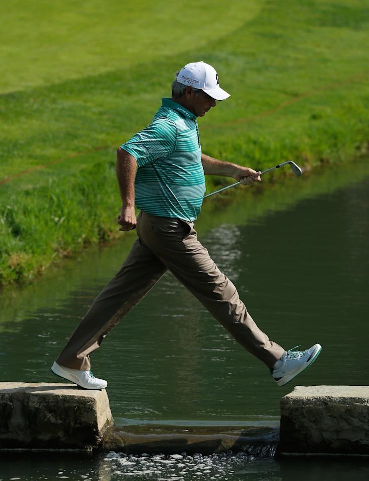 DUBLIN, OH - MAY 31:  Fred Couples crosses a bridge on the 14th hole during the second round of the Memorial Tournament presented by Nationwide Insurance at Muirfield Village Golf Club on May 31, 2013 in Dublin, Ohio.  (Photo by Scott Halleran/Getty Images)