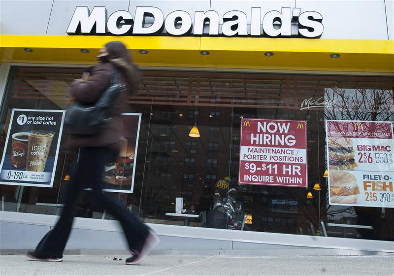 A passersby walks in front of a help wanted sign at a McDonald's restaurant in the Brooklyn borough of New York