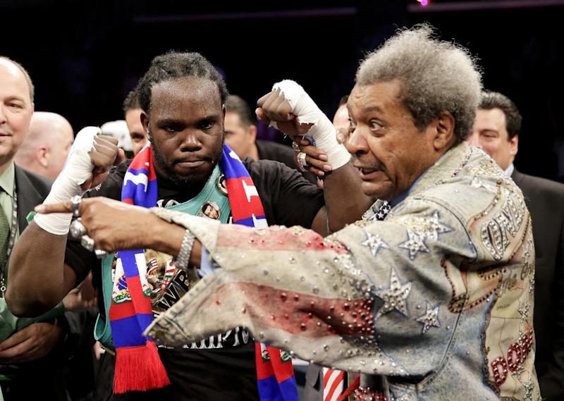 Bermane Stiverne, left, celebrates his win over Chris Arreola with promoter Don King after a rematch for the WBC heavyweight boxing title in Los Angeles, Saturday, May 10, 2014