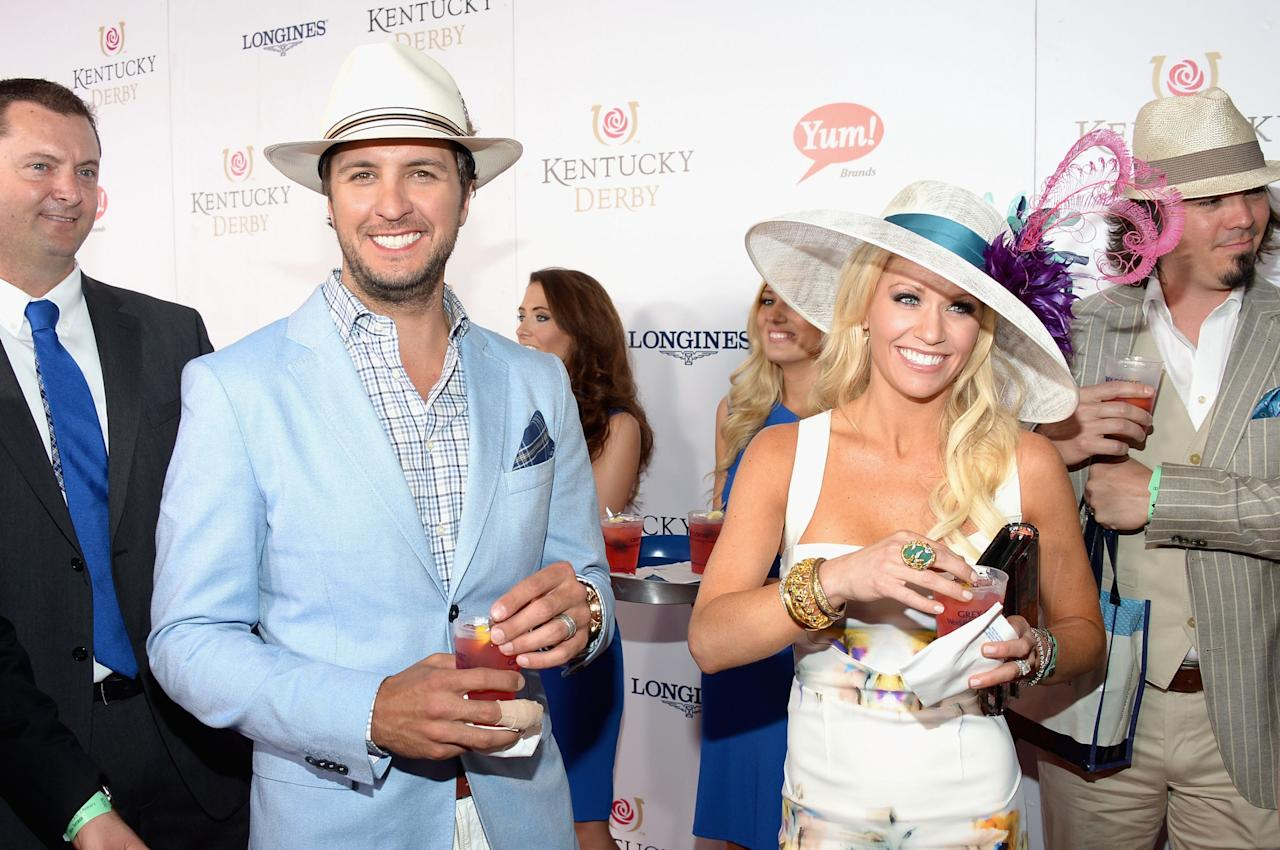 LOUISVILLE, KY - MAY 04: Luke Bryan and Caroline Boyer at the GREY GOOSE Red Carpet Lounge at the Kentucky Derby at Churchill Downs on May 4, 2013 in Louisville, Kentucky.  (Photo by Theo Wargo/Getty Images for GREY GOOSE)