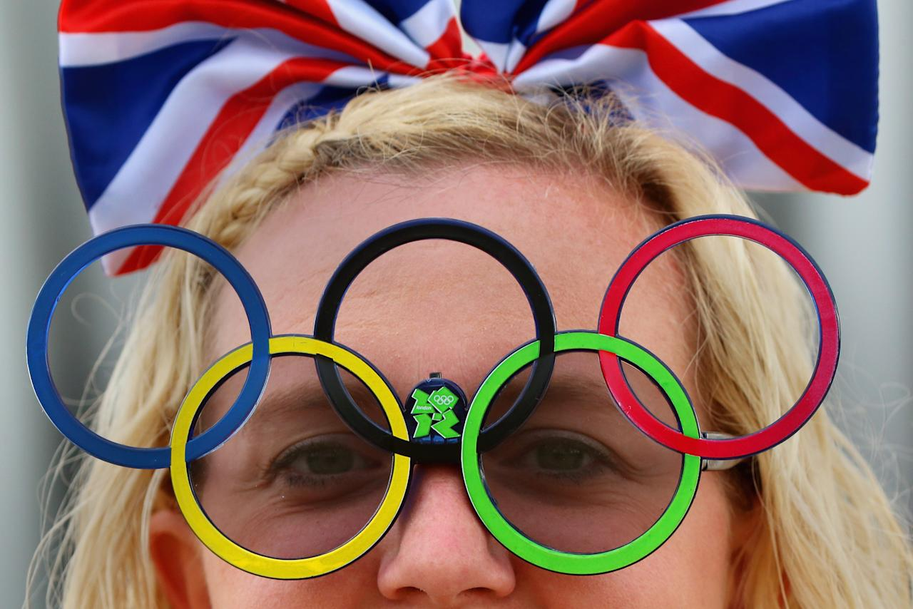 LONDON, ENGLAND - JULY 28: Donna York wears Olympic sunglasses on day one of the London 2012 Olympic Games at the Olympic Park on July 28, 2012 in London, England.  (Photo by Jeff J Mitchell/Getty Images)