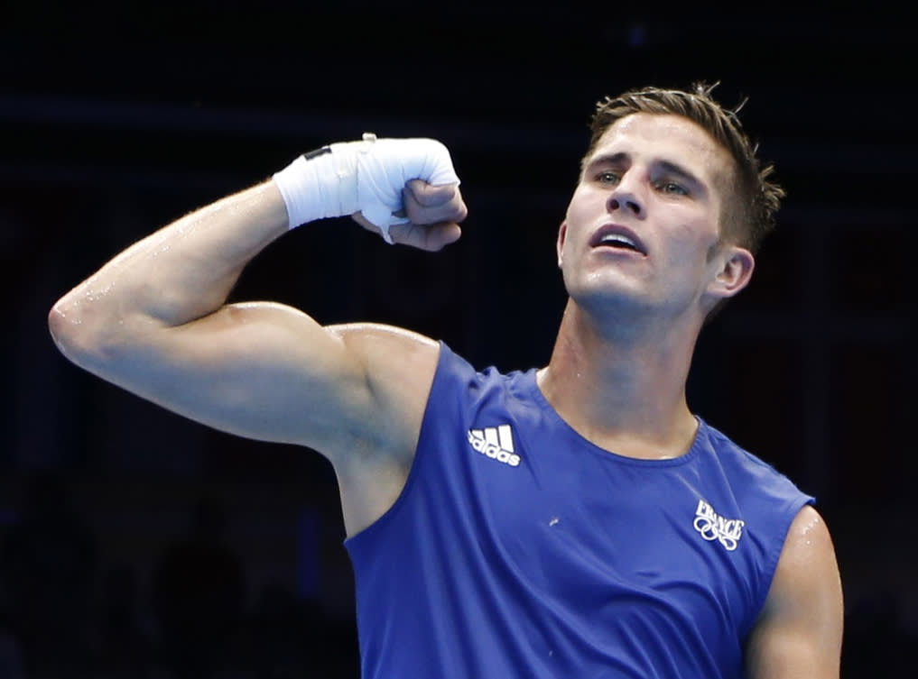 France's Alexis Vastine await the ruling announcing the winner after his men's welter (69kg) quarter-final boxing match against Ukraine's Taras Shelestyuk at the London Olympic Games in this August 7, 2012 file photo. French President Francois Hollande's office confirmed on March 10, 2015 that eight French nationals were among 10 killed in an accident involving two helicopters in Argentina. The Elysee Palace said in a statement that famed sailor Florence Arthaud, Olympic swimmer Camille Muffat and boxer Vastine were among the dead. It added that the accident happened during the filming of a TV programme for the TF1 TV channel.    REUTERS/Murad Sezer/Files (BRITAIN - Tags: SPORT BOXING OLYMPICS OBITUARY DISASTER TRANSPORT)