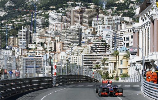 McLaren Mercedes driver Jenson Button of Britain steers his car during the first free practice ahead of the Monaco Formula One Grand Prix at the Monaco racetrack, in Monaco, Thursday, May 13, 2010. The Formula Monaco Formula One Grand Prix will take place here on Sunday, May 16. (AP Photo/Luca Bruno)