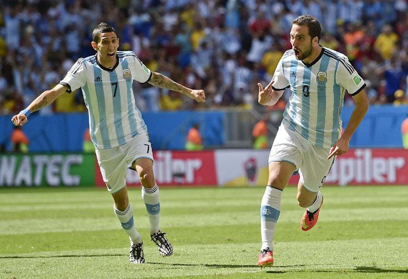 Argentina's Gonzalo Higuain, right, celebrates with Angel di Maria after scoring the opening goal during the World Cup quarterfinal soccer match between Argentina and Belgium at the Estadio Nacional in Brasilia, Brazil, Saturday, July 5, 2014