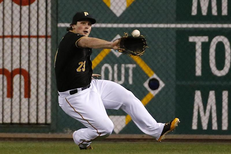 Pittsburgh Pirates right fielder Travis Snider slides to make the catch on a fly ball hit by Milwaukee Brewers' Jonathan Lucroy during the ninth inning of a baseball game in Pittsburgh, Thursday, April 17, 2014. The Pirates won 11-2