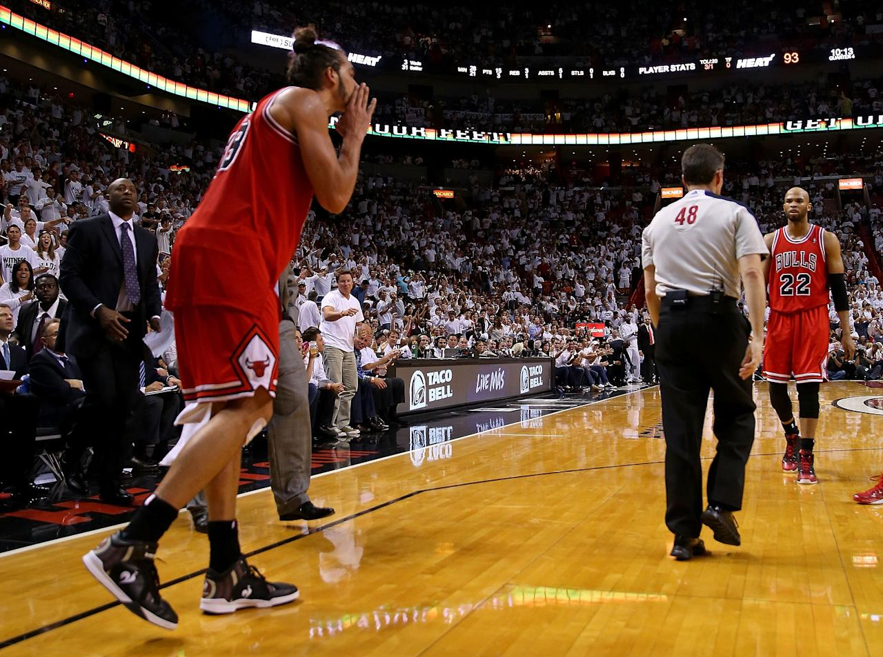 MIAMI, FL - MAY 08:  Joakim Noah #13 of the Chicago Bulls is ejected after arguing with referee Scott Foster #48 during Game Two of the Eastern Conference Semifinals of the 2013 NBA Playoffs against the Miami Heat at American Airlines Arena on May 8, 2013 in Miami, Florida. NOTE TO USER: User expressly acknowledges and agrees that, by downloading and or using this photograph, User is consenting to the terms and conditions of the Getty Images License Agreement.  (Photo by Mike Ehrmann/Getty Images)
