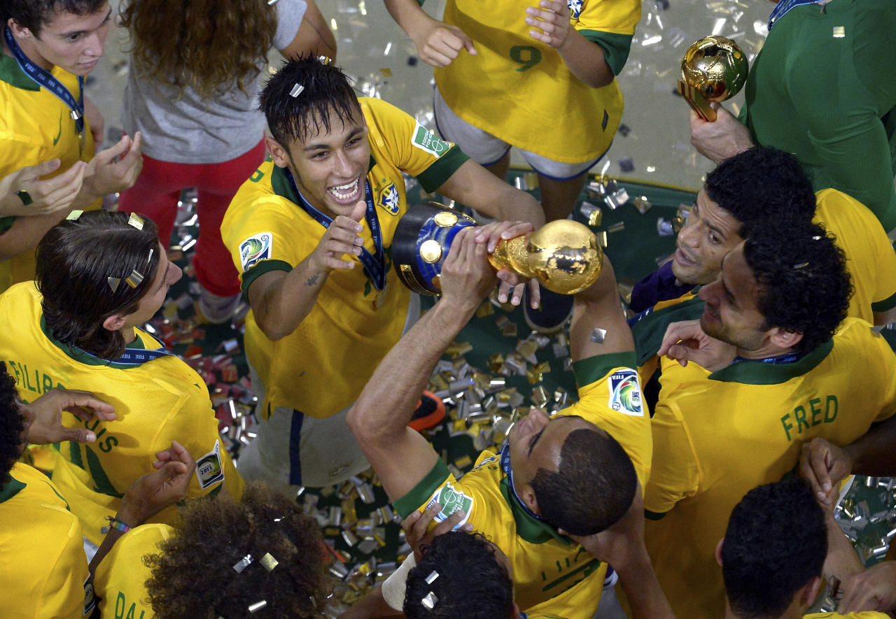 The photo provided by FIFA shows Brazil's Neymar celebrating with his teammates after winning the Confederations Cup final between Brazil and Spain at Maracana stadium in Rio de Janeiro, Brazil, Sunday, June 30, 2013. (AP Photo/Alexandre Loureiro, FIFA via Getty Images)
