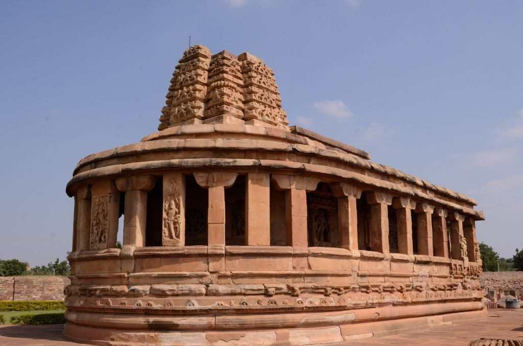 """<p>A visit to Aihole starts with the Durga temple built between the 7th and 8th centuries by the Chalukyas. Ironically, it is not dedicated to Goddess Durga but takes the name after """"Durg"""" or fortress, which may have referred to the proximity of the fort nearby. Built in a fusion of Dravidian and Nagara styles of architecture, the temple's apsidal design is also referred to as """"Gajaprasta"""", referring to the shape of an elephant's back.</p>"""
