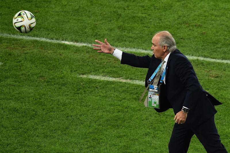 Argentina's coach Alejandro Sabella throws the ball onto the pitch during the final football match between Germany and Argentina for the FIFA World Cup at The Maracana Stadium in Rio de Janeiro on July 13, 2014