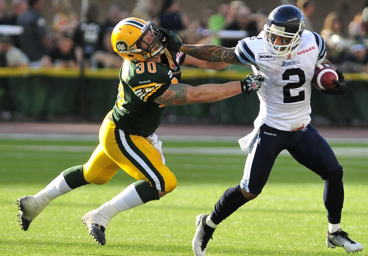 left to right - Edmonton Eskimos player # 30 ( FB) Mathieu Bertrand tries to catch up to Toronto Argonauts player #2 (SB ) Chad Owens during the 3rd quarter of CFL game action between the Edmonton Eskimo's and the Toronto Argonauts at Commonwealth stadium in Edmonton June 30/2012 (CFL PHOTO / Walter Tychnowicz)