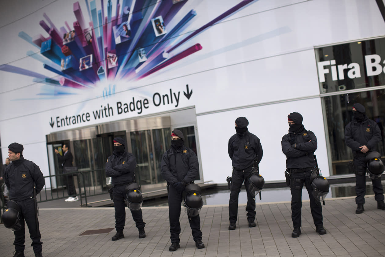 Police officers cordon off one the main entrances at the Mobile World Congress.