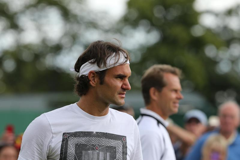 Switzerland's Roger Federer (L) is pictured during a training session with his coach Stefan Edberg on July 5, 2014