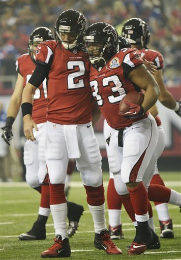 Ryan throws 3 TD passes, Falcons rout Giants 34-0