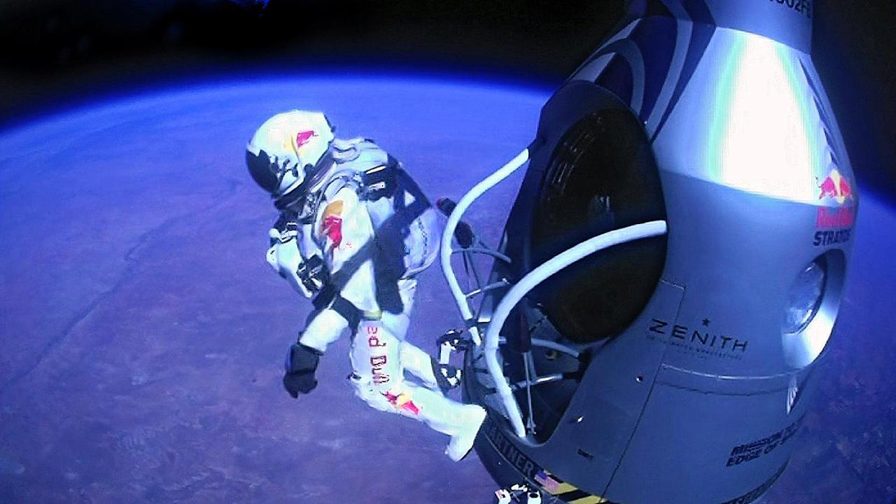 Felix Baumgartner, an extreme athlete, took a major and record-breaking plunge. He jumped from the edge of the Earth's atmosphere—23 miles above—and landed safely after deploying a parachute after the free fall. (Red Bull Stratos/AP Photo)