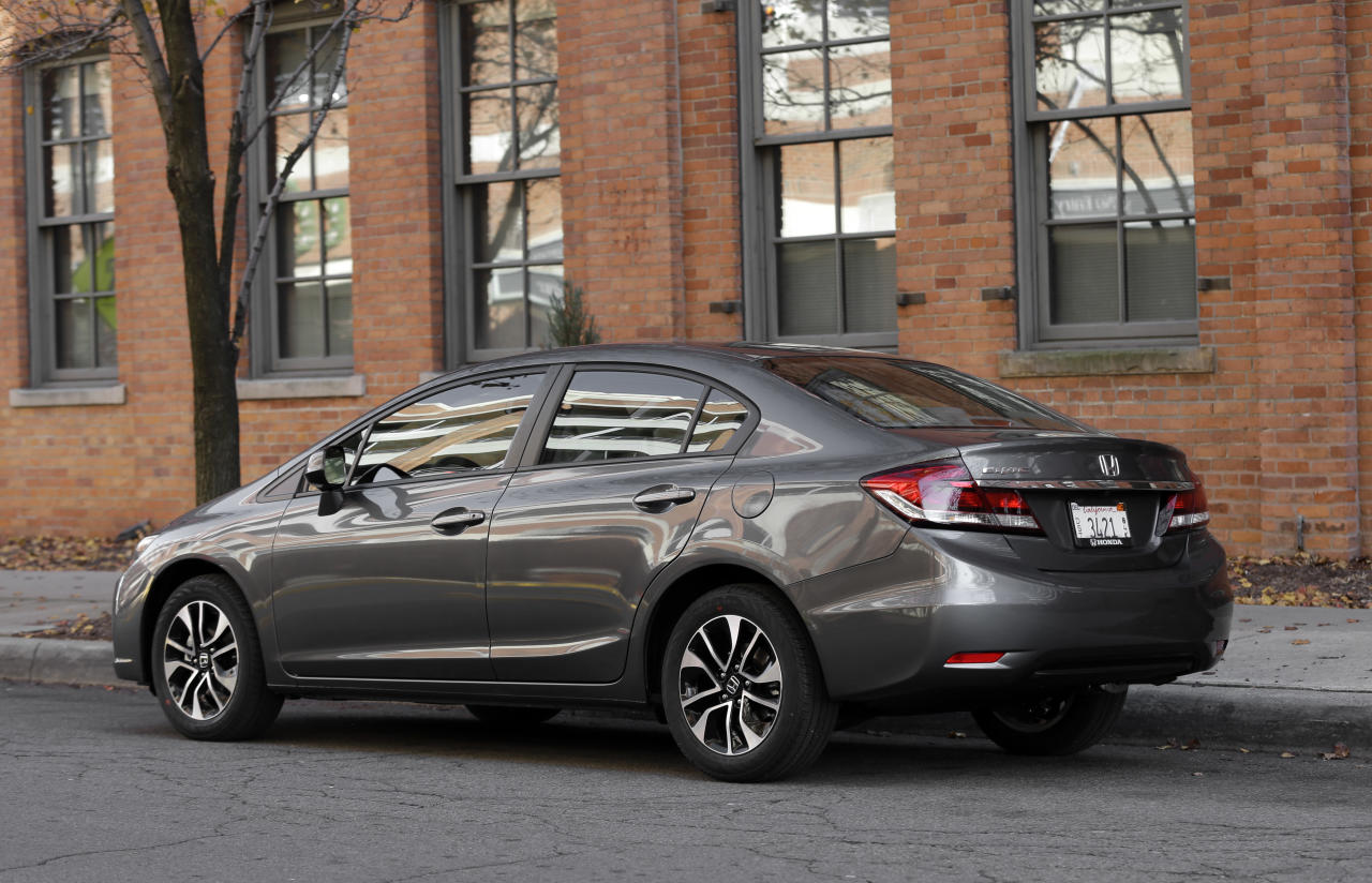 <p>               A 2013 Honda Civic is shown in Detroit, Tuesday, Nov. 27, 2012. Just 19 months after its Civic compact car hit showrooms and got slammed by critics, the company has revamped the vehicle, giving it a new look and upgrading the interior. (AP Photo/Paul Sancya)