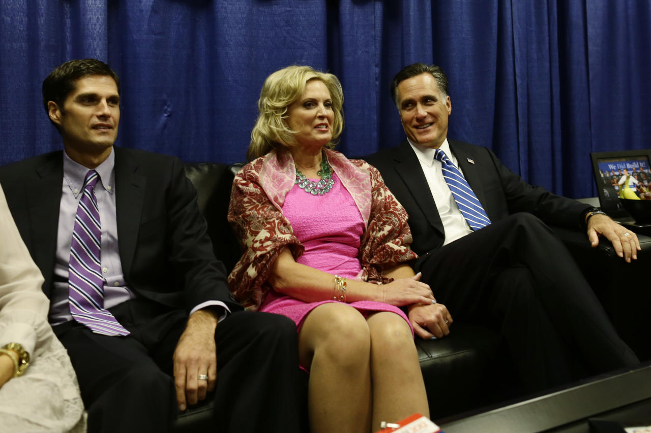 Republican presidential candidate and former Massachusetts Gov. Mitt Romney sits with wife Ann and son Matt in a holding room before he participates in the second presidential debate with President Barack Obama at Hofstra University in Hempstead, N.Y., Tuesday, Oct. 16, 2012. (AP Photo/Charles Dharapak)