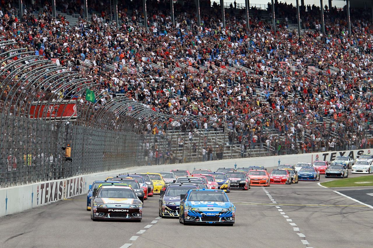FORT WORTH, TX - NOVEMBER 06:  David Ragan, driver of the #6 UPS My Choice Ford and Greg Biffle, driver of the #16 3M Scotch-Blue Painter's Tape Ford, lead the field at the start of the NASCAR Sprint Cup Series AAA Texas 500 at Texas Motor Speedway on November 6, 2011 in Fort Worth, Texas.  (Photo by Ronald Martinez/Getty Images)
