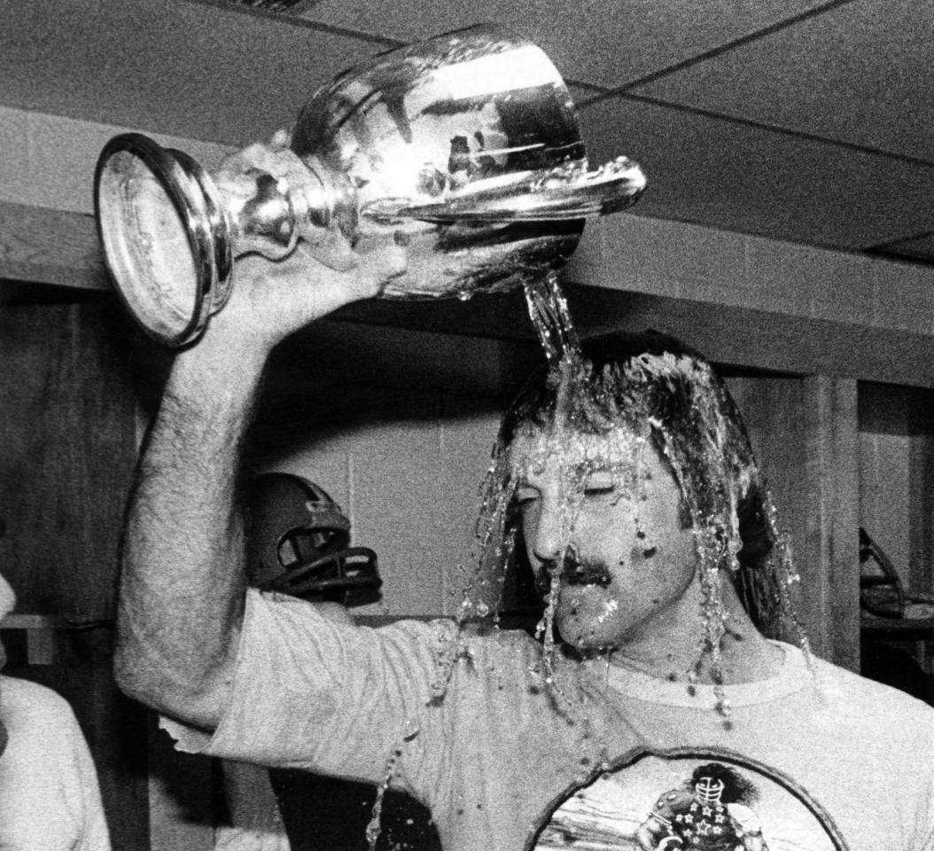 Edmonton Eskimos' Dale Potter celebrates after winning the Grey Cup over the Montreal Alouettes in Toronto on Nov. 26, 1978. The base of the cup is missing after being broken in transport from the field.  The Canadian Press/Andy Clark
