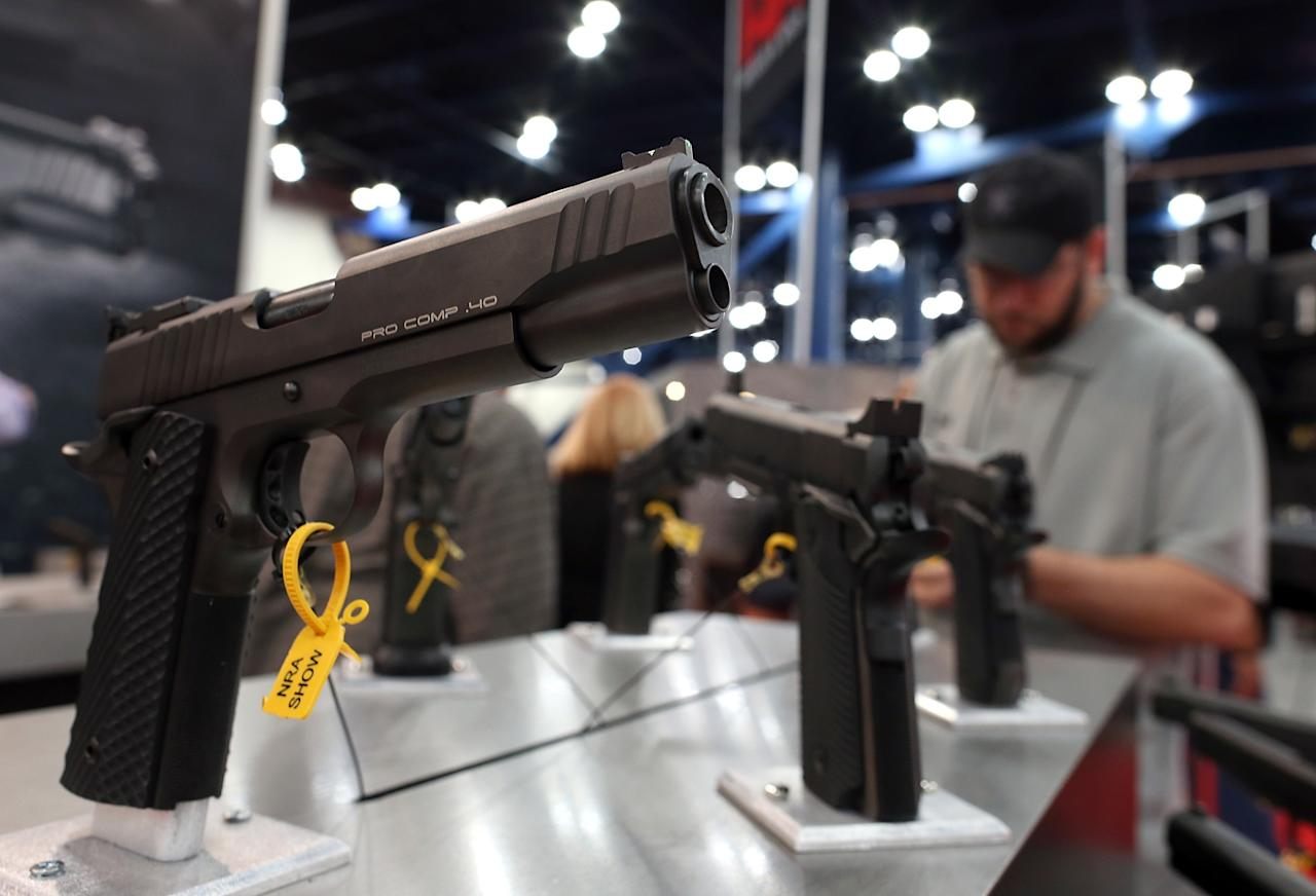 HOUSTON, TX - MAY 05:  Handguns are displayed in the Para booth during the 2013 NRA Annual Meeting and Exhibits at the George R. Brown Convention Center on May 5, 2013 in Houston, Texas.  More than 70,000 people attended the NRA's 3-day annual meeting that featured nearly 550 exhibitors, a gun trade show and a political rally.  (Photo by Justin Sullivan/Getty Images)