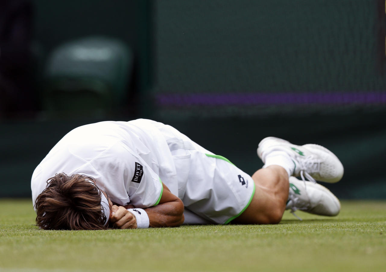 Spain's David Ferrer slips during his match against Argentina's Martin Alund during day Two of the Wimbledon Championships at The All England Lawn Tennis and Croquet Club, Wimbledon.