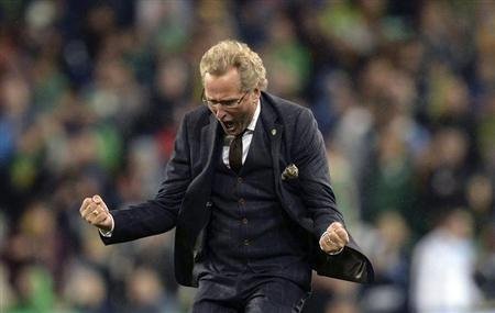 Sweden's coach Hamren celebrates after his side beat Ireland during their World Cup qualifying match in Dublin