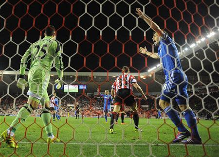 Chelsea's Lampard celebrates scoring against Sunderland during their English League Cup quarter-final soccer match at the Stadium of Light in Sunderland