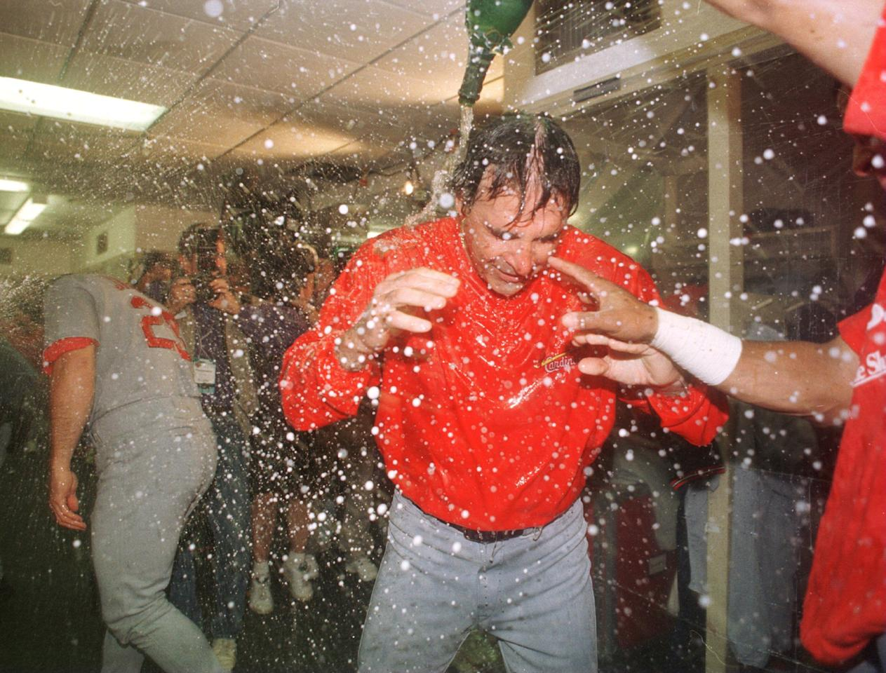 5 Oct 1996: Manager Tony LaRusssa of the St. Louis Cardinals is doused with champagne after his team's 7-5 victory over the San Diego Padres in game three of the National League Divisional Series held at Jack Murphy Stadium in San Diego, California. The C