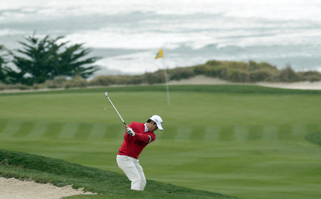 Sang-Moon Bae, from South Korea, hits from a bunker toward the 10th green at Pebble Beach Golf Links during the third round of the AT&T Pebble Beach National Pro-Am golf tournament in Pebble Beach, Calif., Saturday, Feb. 11, 2012. (AP Photo/Marcio Jose Sanchez)