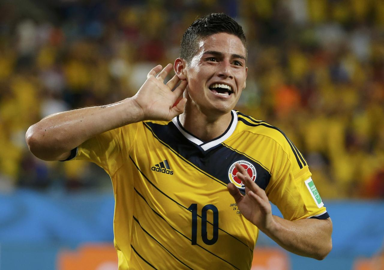 Colombia's James Rodriguez celebrates after scoring a goal during the 2014 World Cup Group C soccer match between Japan and Colombia at the Pantanal arena in Cuiaba June 24, 2014. REUTERS/Eric Gaillard (BRAZIL - Tags: TPX IMAGES OF THE DAY SOCCER SPORT WORLD CUP) TOPCUP