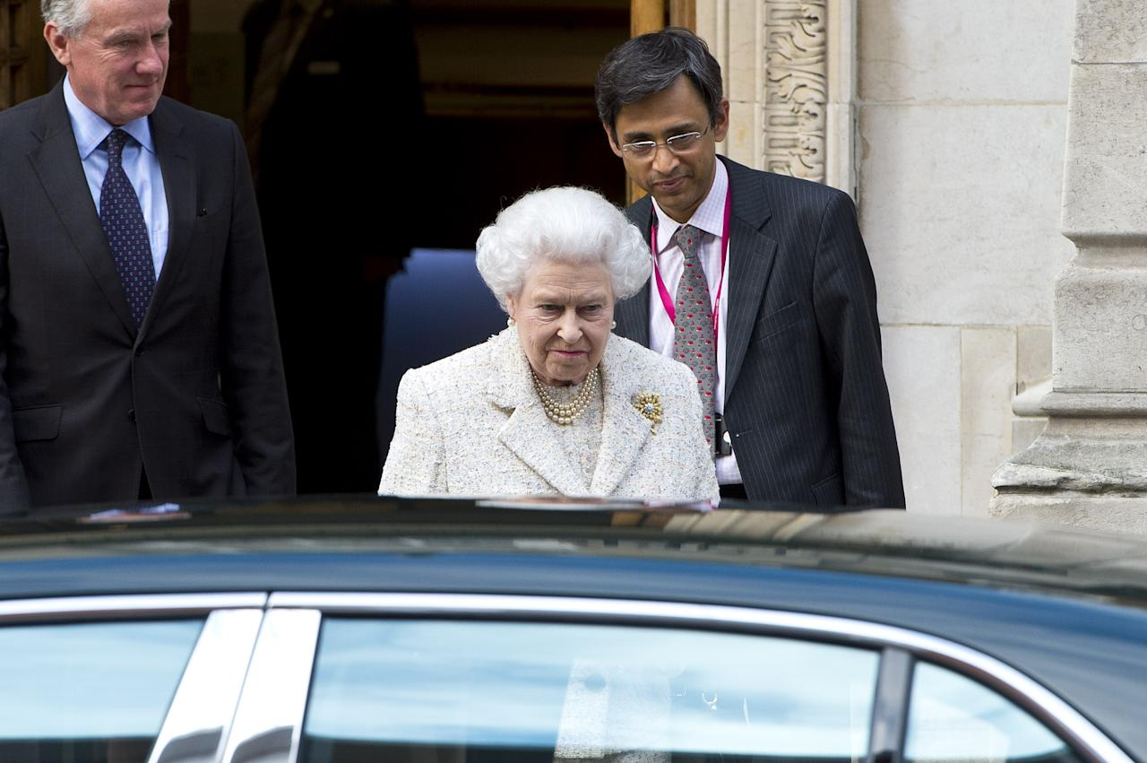 LONDON, ENGLAND - JUNE 10: Queen Elizabeth II departs Hospital after visiting Prince Phillip, Duke of Edinburgh on his birthday on June 10, 2013 in London, England. The Duke of Edinburgh underwent a scheduled operation on his abdomen at the London Clinic on June 7, 2013 and will spend the remainder of his birthday in hospital where he remains under observation. (Photo by Ben A. Pruchnie/Getty Images)