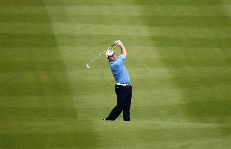 Forsyth hits on the ninth fairway during the first round of the World Cup golf tournament in Donggua