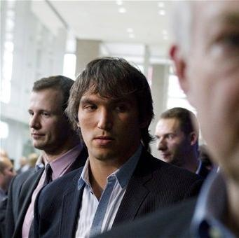 Washington Capitals' Alex Ovechkin, center, and Ottawa Senators' Jason Spezza, left, follow Donald Fehr, executive director of the NHL Players' Association, after talking to reporters following collective bargaining talks, Tuesday, Aug. 14, 2012, in Toronto. (AP Photo/The Canadian Press, Chris Young)