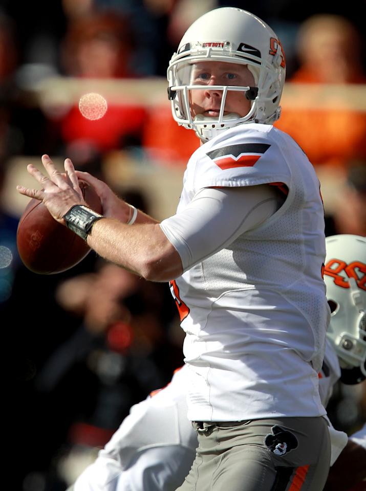 LUBBOCK, TX - NOVEMBER 12:  Brandon Weeden #3 of the Oklahoma State Cowboys throws against the Texas Tech Red Raiders at Jones AT&T Stadium on November 12, 2011 in Lubbock, Texas.  (Photo by Ronald Martinez/Getty Images)
