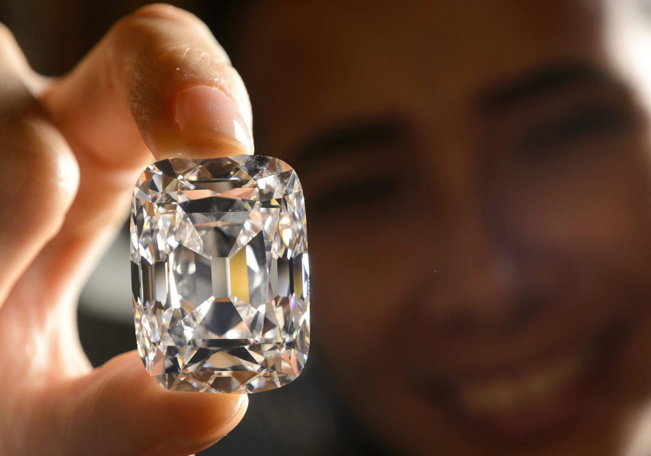 FILE- In this Oct. 4, 2012, file photo, a model holds the Archduke Joseph Diamond, a historical diamond, during a Christie's auction preview, in Geneva, Switzerland. On Tuesday, Nov. 13, 2012 Christie's is selling the Archduke Joseph Diamond, one of the rarest and most famous. The 76.02 carat diamond, with perfect color and internally flawless clarity, came from the ancient Golconda mines in India. It is expected to sell for more than $15 million. In 1993, Christie's auctioned it in Geneva where it sold for $ 6.5 million. (AP Photo/Keystone, Laurent Gillieron, File)
