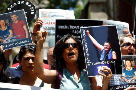 Demonstrators shout slogans as they hold pictures of Ahmet Nesin, Sebnem Korur Fincanci and Erol Onderoglu during a protest against arrest of the three prominent campaigners for press freedom, in front of the pro-Kurdish Ozgur Gundem newspaper in central Istanbul, Turkey, June 21, 2016. REUTERS/Murad Sezer