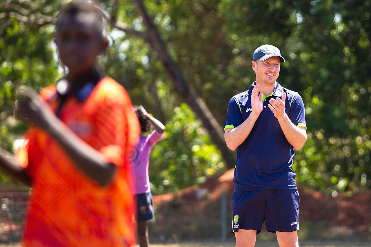 DARWIN, AUSTRALIA - AUGUST 10:  Brad Haddin of the Australian cricket team plays cricket with children during a visit to Pirlangimpi of the Tiwi Islands on August 10, 2012 on the Tiwi Islands, Australia.  (Photo by Mark Nolan/Getty Images)