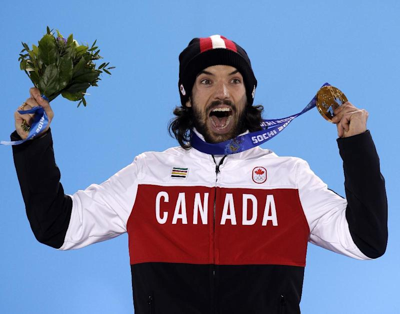 Charles Hamelin of Canada, who won the gold medal in men's 1,500-meter short track speedskating celebrates during the medals ceremony at the 2014 Winter Olympics, Monday, Feb. 10, 2014, in Sochi, Russia