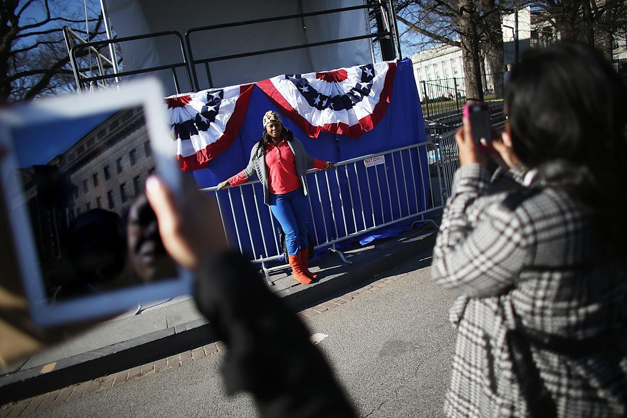 WASHINGTON, DC - JANUARY 20:  Yvette Adams poses in front of inaugural bunting as Washington prepares for U.S. President Barack Obama's second inauguration on January 20, 2013 in Washington, DC. One day before the public inaugural ceremony at the U.S. Captiol on January 21, Obama was officially sworn in for his second term during a private ceremony surrounded by friends and family in the Blue Room of the White House.  (Photo by Mario Tama/Getty Images)