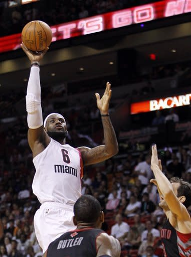 James, Heat hold back Raptors, 95-89