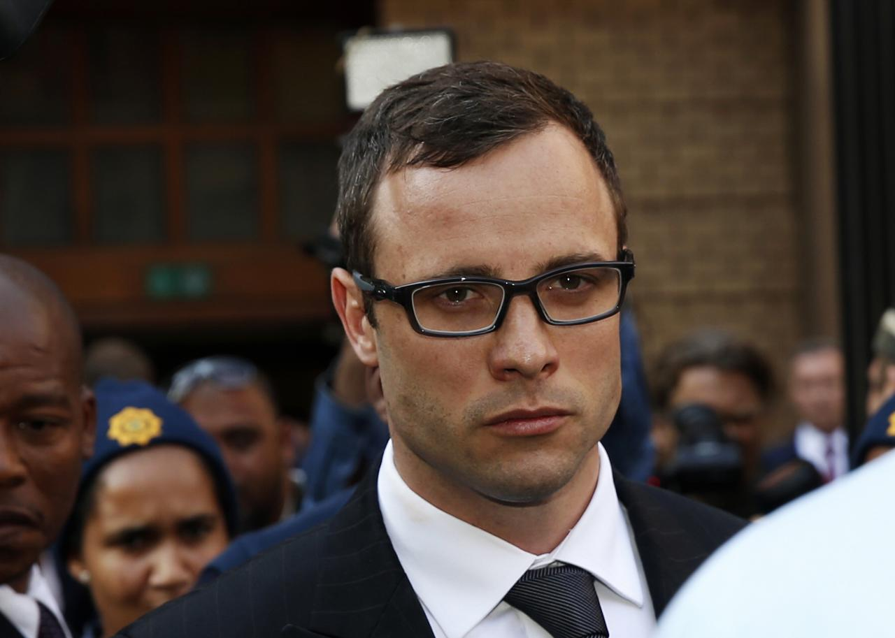 Paralympic track star Oscar Pistorius leaves after listening to the closing arguments in his murder trial at the high court in Pretoria August 7, 2014. Pistorius, once a national icon for reaching the pinnacle of sport, is accused of murdering his law graduate and model girlfriend Reeva Steenkamp at his home in Pretoria on Valentine's Day last year. If found guilty of premeditated murder, he could face life in prison. A potential lesser charge of culpable homicide could carry a sentence of 15 years. REUTERS/Siphiwe Sibeko (SOUTH AFRICACRIME LAW - Tags: SPORT ATHLETICS CRIME LAW HEADSHOT)