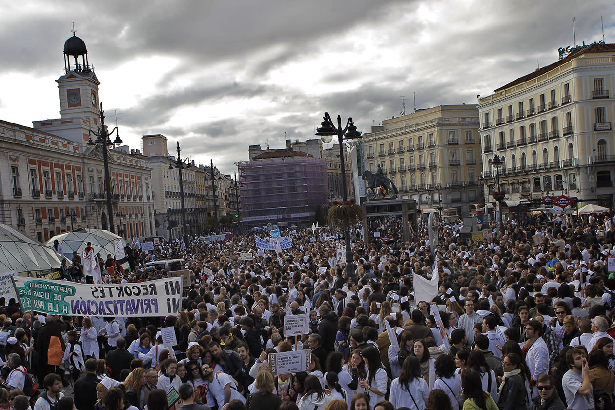 Protestors march during a demonstration against government-imposed austerity measures and labor reforms in the public health care sector in the centre of Madrid.