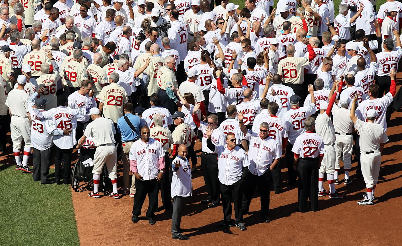BOSTON, MA - APRIL 20:  Former Boston Red Sox players, coaches and managers wave to the fans in a ceremony before the game between the New York Yankees and the Boston Red Sox on April 20, 2012 at Fenway Park in Boston, Massachusetts. Today marks the 100 year anniversary of the ball park's opening.  (Photo by Elsa/Getty Images)